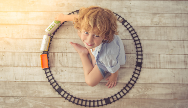 child with lgb train playing