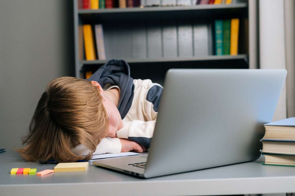 kid sleeping on laptop