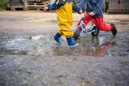 Kids Play Outside in Bad Weather
