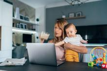 mom with baby working from home