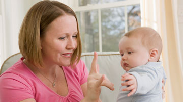 Does sign language replace speaking to my baby?